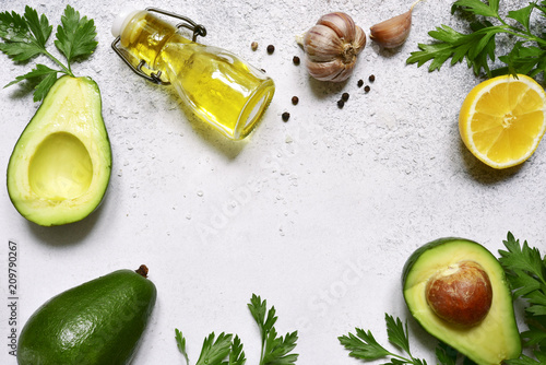Foto Murales Food background with ingredients for making mexican avocado dip guacamole.Top view with copy space.