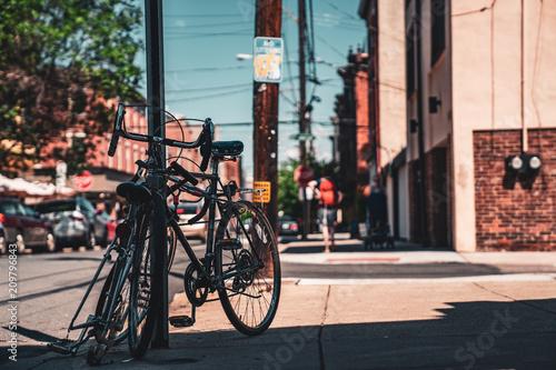 Plexiglas Fiets Bike Leaning on Street side on South Philadelphia Street