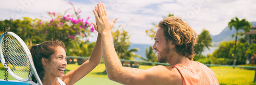 Aluminium Fitness Summer sport tennis players having fun doing high five after game. Healthy lifestyle outdoor living mixed doubles banner panorama.