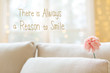 There Is Always A Reason to Smile message with a flower in a bright interior room sofa