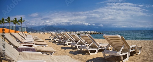 Beach, city and ocean view in Puerto Vallarta Mexico with beach chairs and coastline. - 209806486