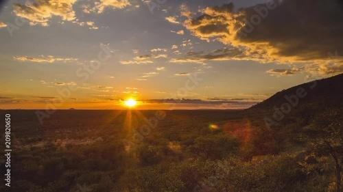 Time Lapse of Namibia desert. Sun setting over desert.