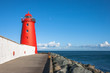 Red Poolbeg Lighthouse on Great South Wall, Dublin, Ireland  - 209829283