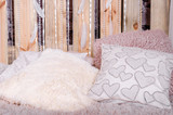 Bedroom loft design with bed soft pillows canopy swing with white tulips dream catcher with feathers and pearls hanging on a wooden background - 209832204