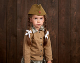 child girl are dressed as soldier in retro military uniforms - 209844472