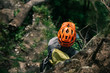 high angle view of male traveler in protective helmet standing in forest