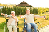 Senior man and woman from care home doing exercise outdoors - 209848222
