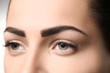 Young woman with permanent eyebrows makeup, closeup - 209848668