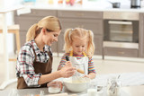 Mother with daughter making dough together in kitchen - 209848857