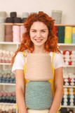 Colorful clews. Red-haired beaming girl feeling extremely enthusiastic while holding three big colorful clews - 209849045