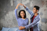 Attractive African-American couple dancing at home - 209849210