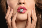 Young woman with beautiful ring in mouth, closeup - 209849493