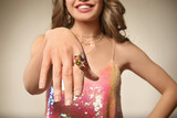 Beautiful young woman with elegant ring on color background, closeup - 209849612