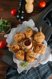 Fried quail legs in coating served with sauce in egg shell - 209850494