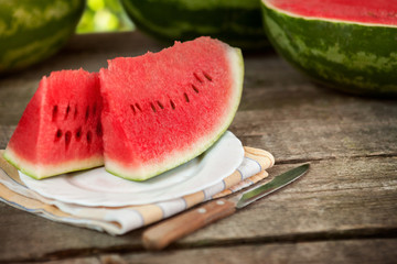 Sweet watermelon on plate and knife