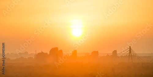 Sticker Sunset in the city. Skyline with orange sun on sky