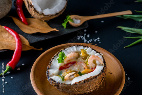 Fototapeta coconut soup in a half of coconut. Thai cuisine