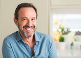Fototapety Handsome middle age man with a happy face standing and smiling with a confident smile showing teeth