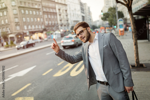 Businessman waving for a taxi