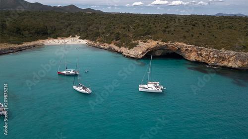 Fotobehang Groen blauw luxury yacht on the coast of Majorca, overlooking cliffs