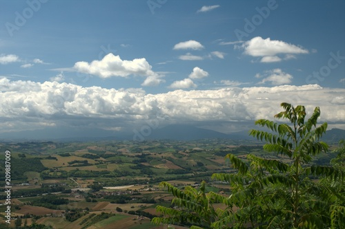 Fotobehang Blauwe jeans Center of Italy,hills,panorama,landscape,crops,field,view,sky,clouds,countryside,white,blue