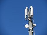 Telephone antenna on blue sky background - 209907250