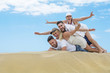 Group of friends in the sand, on summer holidays.