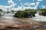 Tropical waterfall with blue sky and white clouds