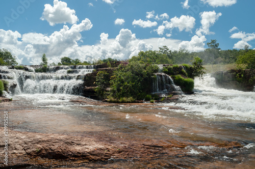 Tropical waterfall with blue sky and white clouds - 209925258