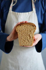 Sliced homemade bread in the hands of a baker