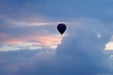 balloon with people flying in the colored sky