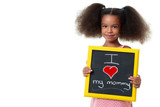 Cute african american girl holding a sign with the phrase I love my mommy - 209941688
