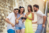 Group of young tourist friends with digital tablet having fun - 209947867