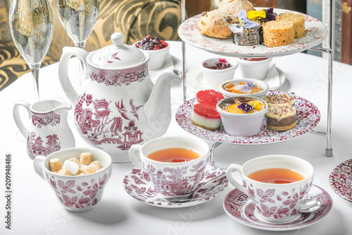 Fototapeta old school style tea at five afternoon service sandwich set cake sweet traditional table hotel cheesecake sugar pot china cup