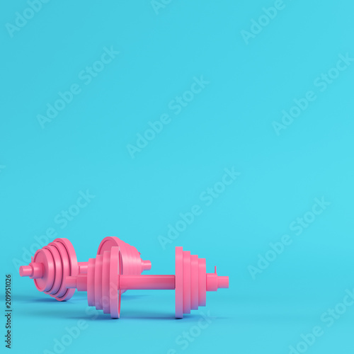 Fototapeta Abstract pink dumbbells bright blue background in pastel colors
