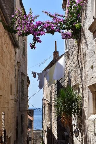 Fototapeta Get lost in the cobbled stone narrow streets in the old town of Korcula, Korcula island, Croatia, June 2018