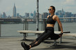 Outdoor training of young attractive brunette woman. Concept sporty healthy lifestyle.