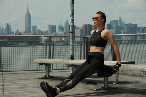 Fotobehang Fitness Outdoor training of young attractive brunette woman. Concept sporty healthy lifestyle.