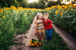 Beautiful children in the field with sunflowers