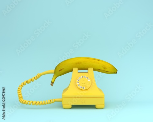 Creative idea layout fresh banana with yellow retro telephone on bluish background.  Fruit minimal concept. - 209973065