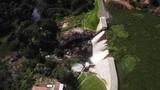 Bird's eye drone shot descending over a hydroelectric power dam - 209979648