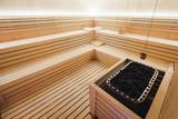 Beautiful sauna interior with stones - 209988423