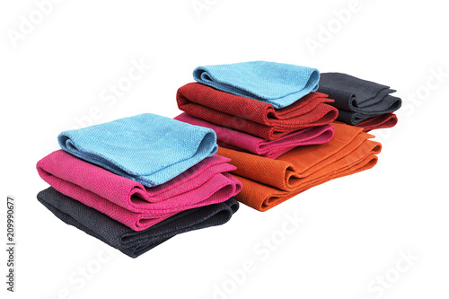 Pile of colored towels isolated on white background 3d without shadow