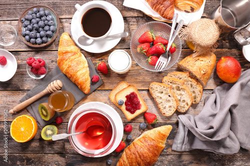 breakfast with coffee, tea, croissant and fruit © M.studio