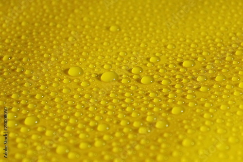 Foto Murales natural water drops on yellow background texture