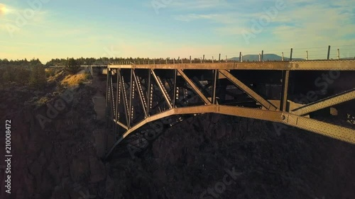 Obraz na płótnie Drone footage of a trestle bridge at sunset in the desert