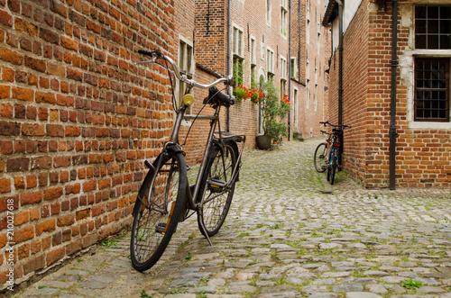 Foto Murales Bicycle is posted on the road in Begijnhof Leuven