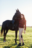Black horse and an attractive young woman - 210051460