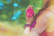 close up of yoga woman hands in namaste gesture with rose flower outdoor