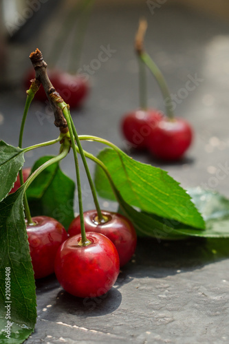 Fotobehang Kersen Ripe cherry on a dark table